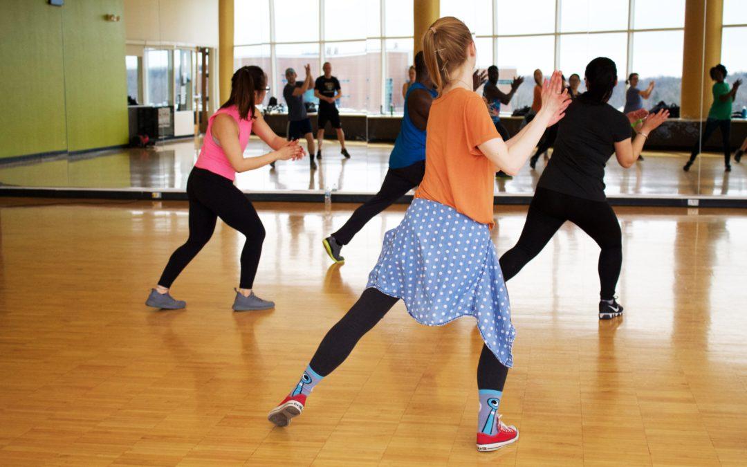 women dancing near mirror